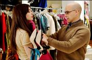 "Anne Hathaway, left, plays a fashion magazine underling who gets a makeover from the publication&squot;s art director (Stanley Tucci) in the comedy ""The Devil Wears Prada."""