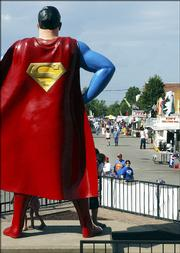 Steve Jahnke/AP PhotoA 15-foot bronze statue of the comic-book hero overlooks Superman Square in Metropolis, Ill., during Wednesday's annual Superman Celebration.