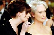 "Anne Hathaway, left, plays the new assistant of a high-powered fashion magazine editor (Meryl Streep) in the comedy ""The Devil Wears Prada."""