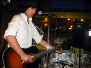 Pete Yorn tunes up during a recent in-store show at Salzer's in Ventura, Calif.