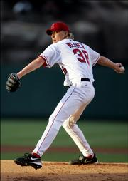Los Angeles Angels starting pitcher Jeff Weaver pitches against the Colorado Rockies. Weaver gave up six runs in two innings in the Angels' 12-4 loss on Tuesday.