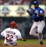 Kansas City Royals shortstop Angel Berroa, right, bobbles the ball after forcing out St. Louis Cardinals' David Eckstein. Berroa was unable to convert the double play in the Royals' 7-5 victory Friday in St. Louis.