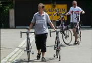 T-Mobile employees carry bicycles outside the team hotel in Blaesheim, France. Tour de France favorites including T-Mobile rider Jan Ullrich were barred Friday from riding in this year's race because of a doping scandal, causing a massive upheaval on the eve of cycling's premier event.
