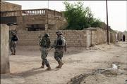 U.S. Army soldiers from the 1st Battalion, 502nd Infantry Regiment conduct a routine patrol in May in Mahmoudiyah, Iraq. The U.S. Army will investigate charges that five American soldiers from the unit were involved in the killings of four Iraqi relatives, including a woman who had been raped, military officials said Friday.