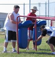 Participants in Free State and Lawrence High Schools' football camp run defensive drills on June 26.  The camp ran from June 26-29.
