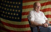 Lawrence resident Bob Evans, 85, is pictured before an 1876 38-star American flag handed down to him from his grandfather, Henry Sylvanus Rockey, who was a Union soldier with the Ohio Volunteers during the Civil War.