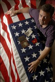 John Van Sickel, of Lawrence, has an American flag passed down from when his grandfather was killed in World War I.