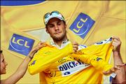 Overall leader Tom Boonen of Belgium slips on the yellow jersey Wednesday after the fourth stage of the Tour de France.