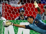 Portugal goalie Ricardo is unable to stop a penalty kick by France's Zinedine Zidane during the World Cup semifinals. France advanced to the finals with Wednesday's 1-0 victory in Munich.