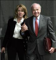 Enron founder Kenneth Lay and his wife, Linda, return to the federal courthouse after lunch in week 10 of his fraud and conspiracy trial in this April 4 photo in Houston. Lay, who was convicted of helping perpetuate one of the most sprawling business frauds in U.S. history, died Wednesday of a heart attack in Colorado. He was 64.