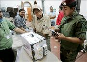 A Mexican soldier keeps inventory of the ballot boxes that leave a secure area for the final count of the presidential election in Mexico City. The official recount began Wednesday.