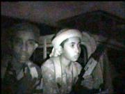This image taken from an Islamic militant recruitment video purports to show young Arab fighters on the back of a truck as they prepare for battle in Mogadishu, Somalia. Islamic militants in Somalia have previously denied the presence of any foreign fighters.