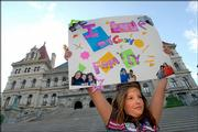 Mariah Richard, 11, of Watervliet, N.Y., whose parents are gay, holds up a sign during a rally in support of same sex marriage in Albany, N.Y. New York's highest court ruled Thursday that gay marriage is not allowed under state law, rejecting arguments by same-sex couples who said the law violates their constitutional rights.