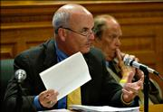 Rep. Jim Ward, D-Wichita, a member of the special House committee assigned to investigate Kansas Supreme Court Justice Lawton Nuss, talks about what the committee has learned up to this point and what steps they should take Thursday at the Statehouse in Topeka. Rep. Mike Peterson, D-Kansas City, listens in the background.