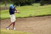 Nick Burkart takes a shot from a sandtrap on the front nine. Burkart, 17, shot an 82 in the final round of the Lawrence Amateur Golf Assn.'s Big Event on Sunday at Alvamar Golf Course.