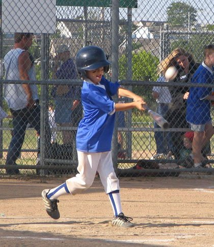 Dragon Gus Stone swings in the top of the third inning in his third- and-fourth grade Parks and Recreation Rec Baseball match-up against the Bobcats. The Bobcats defeated the Dragons 16-10.