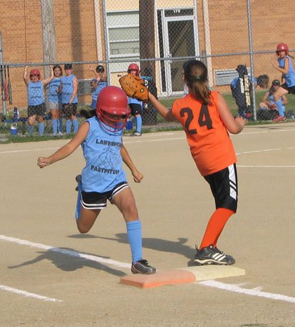 MittBurner Raclei Gillespie tags first base in the first inning in her team's U10 lower Lawrence Girls Fast Pitch match-up against the Orioles.  The Orioles defeated the MittBurners 6-5 Thursday,