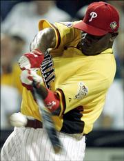 The Phillies' Ryan Howard connects during the Home Run Derby. Howard won the event Monday in Pittsburgh.