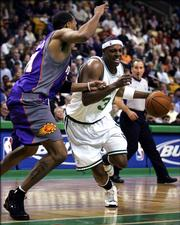 Boston Celtics' Paul Pierce, right, drives past Phoenix Suns' Shawn Marion. Pierce, a former Kansas University All-American and five-time NBA All-Star, is in no rush to sign a contract extension with Boston.