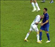 French soccer player Zinedine Zidane, left, headbutts Italy's Marco Materazzi. Zidane was ejected from the World Cup final Sunday in Berlin.