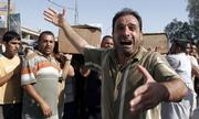 An Iraqi man on Monday mourns the loss of his two brothers killed in Sunday's double car bomb attack in Baghdad, Iraq. Two car bombs exploded Sunday evening near a Shiite mosque in the city's north, killing 17 people and wounding 38 in what appeared to be a reprisal attack, police said.
