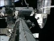 the space shuttle Discovery's nose and the International Space Station can be seen during the second spacewalk Monday in this image made from NASA TV.