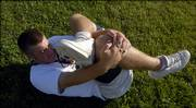 LHS football player Nick DeBiasse stretches his back Thursday morning at the LHS practice field. DeBiasse suffered a stress fracture in his lower back during the baseball season but expects to be ready to take the field when football practice starts Aug. 14.