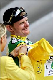 American Floyd Landis slips on the yellow jersey after taking the overall lead in the Tour de France. Landis finished third in the 11th stage Thursday between Tarbes in southwestern France and Pla de Beret, Spain.