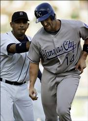 Detroit Tigers shortstop Carlos Guillen, left, tags out Kansas City Royals' John Buck (14). Buck got caught in a rundown between first and second during the second inning of the Royals' 6-4 loss to the Tigers on Thursday in Detroit.