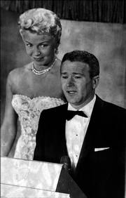 Red Buttons gives his acceptance speech after winning the Academy Award for best supporting actor on March 26, 1958. Looking on is Lana Turner. Buttons died of vascular disease at his home Thursday in Los Angeles.