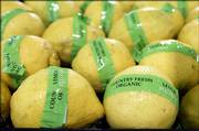 A display of organic lemons is shown at a new upscale Wal-Mart store in Plano, Texas. Wal-Mart Stores Inc. said this year it would double its organic offerings.
