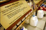 Signs at the St. Louis Park, Minn., Byerly's store explain the shortage of organic milk products.