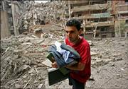 A Lebanese man salvages his briefcase and some clothes from his destroyed apartment next to the demolished headquarters of Hezbollah, in the suburbs of Beirut, Lebanon, following Israeli air strikes on Sunday. Israeli warplanes also bombed the Lebanese capital again this morning.