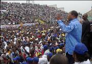Congo presidential candidate Oscar Kashala speaks at a campaign rally in Kinshasa, Congo. The Congolese-born doctor has returned to his home country after nearly two decades in Boston to vie for the presidency against more than 30 other candidates in the July 30 elections.