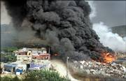 Smoke billows from a blaze started by an explosion in Kfarshima, near Beirut, Lebanon. Lebanese TV stations broadcast video pictures Monday claiming to be an Israeli military aircraft falling to the ground in the area, but the Israeli military said no aircraft was shot down over Beirut.