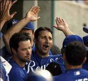 Kansas City's Tony Graffanino, center, celebrates with teammates after scoring on a Shane Costa single during the Royals' game against the Los Angeles Angels. Graffanino's swell mood turned sour later Saturday when he was ejected during the eighth inning for arguing with umpire Joe West. The Angels won the game, 4-3, in 10 innings at Kauffman Stadium.