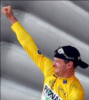 Floyd Landis reacts on the podium following the 19th stage of the Tour de France. Landis regained the overall lead and the yellow jersey Saturday and barring a collapse will win the tour today in Paris.