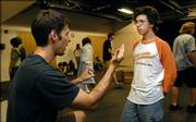 "Director Don Schawang instructs one of his young actors, Andrew Connolly, during a break from a recent rehearsal of ""Caucasian Chalk Circle"" at the Lawrence Arts Center, 940 N.H."