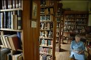 Martha Cutter Kelley Smith, 100, of Vinland, waits for visitors inside the Coal Creek Library in Vinland, where she has served as librarian intermittently for almost 70 years. In August 1926, at the age of 21, Kelley became the 11th person to serve at the library, founded in 1859. She served for 18 years until 1944 when she took maternity leave.  In May 1956 Martha again took on the responsibilities of the librarian where she continues to serve in that capacity, opening the building on Sunday afternoons from April to October.