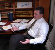 Douglas County District Attorney Charles Branson talks about his plans to help Douglas County residents fight fraud in this 2006 file photo. Branson will be among the speakers at a public forum on senior safety in October.