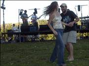 Sage Warren, left, and Mike Self, both of Lawrence, dance to music from Tri Point Paradox. The annual concert Music for the Masses was Saturday at Burcham Park, with donations being taken to help musician Kirk Rundstrom.