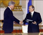 Former U.S. President Bill Clinton and Russian President Vladimir Putin shake hands after signing agreements to dispose of 68 tons of weapons-grade plutonium and share early-warning data on missile and space launches in the Kremlin in Moscow, in this June 4, 2000, file photo.