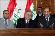 From left, Iraq's speaker of the Parliament Mahmoud al-Mashhadani and President Jalal Talabani listen to the country's Prime Minister Nouri al-Maliki address reporters Saturday in Baghdad. Iraq. Al-Maliki said he will urge U.S. officials to work for a cease-fire in Lebanon when he visits Washington soon.