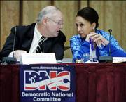 James Roosevelt Jr., left, and Alexis Herman, right, Democratic National Committee Rules and Bylaws Committee co-chairs, confer during the committee's Saturday meeting in Washington to draft the party's 2008 delegate selection rules and the call for the 2008 Democratic National Convention.