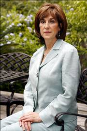 Dr. Anna Pou poses for a photograph Saturday at her home in New Orleans. Pou and two nurses, Cheri Landry and Lori Budo, were arrested Monday and accused of being principals to second-degree murder in the deaths of four patients at Memorial Medical Center three days after Katrina hit. Formal charges will be up to the New Orleans prosecutor.