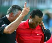 An emotional Tiger Woods, right, walks off the 18th green with caddie Steve Williams after Woods won the British Open. Woods won Sunday in Hoylake, England, and dedicated the victory to his departed father.
