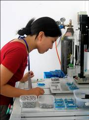 A Horizon worker assembles parts of hydrogen-powered devices this month in Shanghai, China.