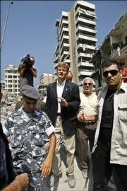 Jan Egeland, center, the United Nations' top humanitarian official, inspects the destruction wrought by Israeli air raids on south Beirut, Lebanon. Egeland on Sunday announced that the world body would begin a major relief operation in the next few days.