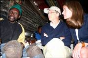 Bill and Melinda Gates sit with tuberculosis patient Nkosebaca Thingathinga in Khayelitsha, South Africa. Their foundation gave him money but not a new house. As the Gateses become more involved in philanthropic work they are refining their approach to charitable giving and discovering the limits of what money can do.