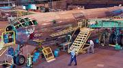 "Volunteers work on restoring ""Doc,"" a World War II-era B-29 Superfortress, inside a Boeing hangar in Wichita in preparation for  the McConnell Air Force Base Open House in September. Since the plane arrived in Wichita on the back of a flatbed truck in 2000, an all-volunteer crew has worked thousands of hours restoring the plane."
